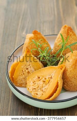 typical brazilian dish coxinhas de frango - stock photo