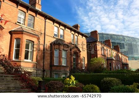 Typical brick houses in Dublin, Ireland. Behind - Aviva stadium - stock photo