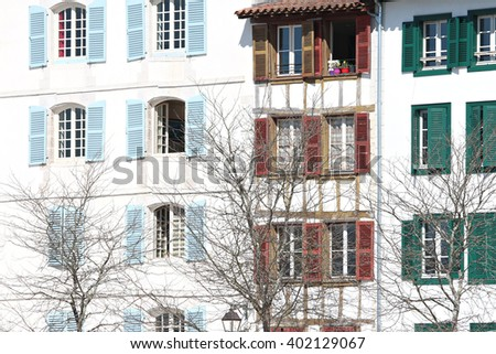 Typical building facade with shutters Basque colors in Bayonne - stock photo
