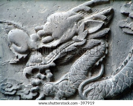 Typical Chinese carven dragon one wall expressing power and status in ancient China - stock photo
