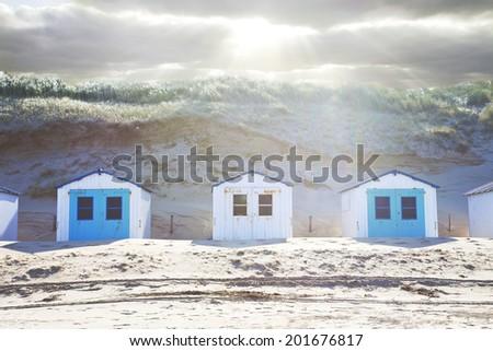 Typical Dutch beach houses in a row - stock photo