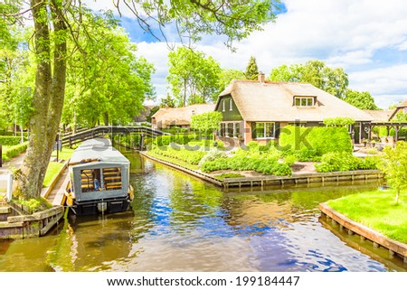 Typical Dutch houses and gardens in Giethoorn, The Netherlands - stock photo