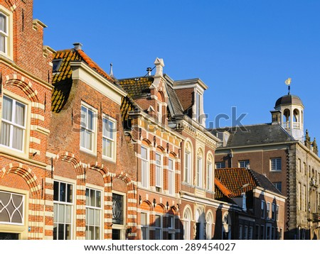 Typical Dutch houses in historical center of Enkhuizen, The Netherlands - stock photo