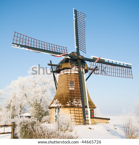 Typical Dutch landscape with snow - stock photo