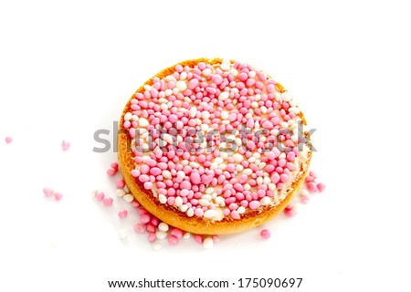 Typical Dutch rusk with pink sprinkles - stock photo