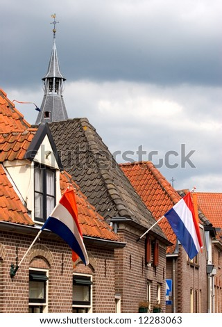 Typical Dutch small town on Queen's Day - stock photo