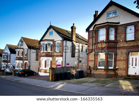 typical english houses in neighborhood - stock photo