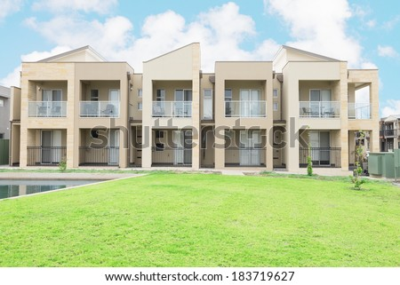 typical facade of a modern town suburban house at noon - stock photo