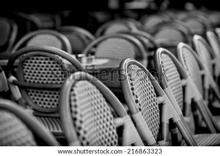 Typical french chairs on the sidewalk, to be found everywhere, of terrace in Paris, capital of France, in the early morning without people - stock photo