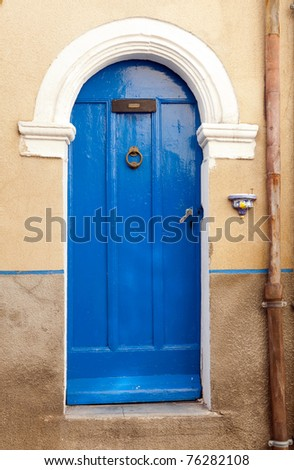 Typical French pastel colored village door in Provence - stock photo