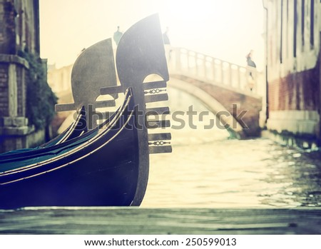 """Typical gondolas in venice, detail of the bow called """"canal grande"""". - stock photo"""