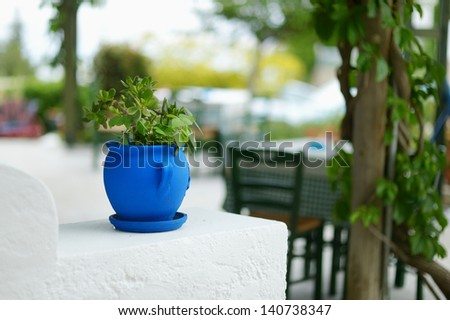Typical greek courtyard with blue flower pot on Kos - stock photo