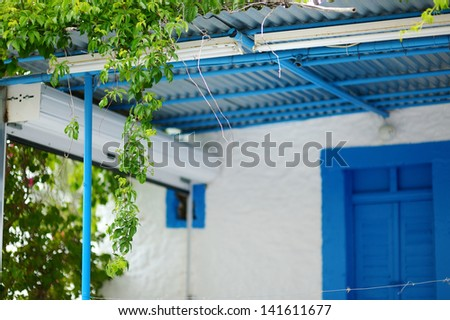 Typical greek white and blue courtyard on Kos island - stock photo