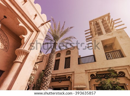 typical historic arabian buildings in the sun - stock photo