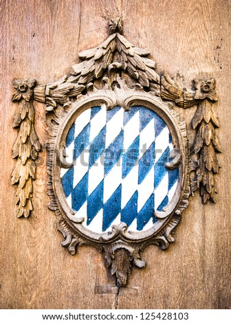 typical historic bavarian coat of arms - blue and white checked - stock photo