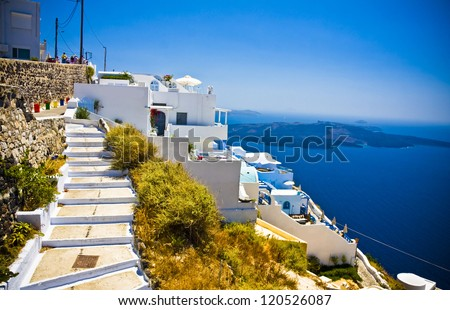 Typical houses and street in centre of Oia in Santorini, Greece - stock photo