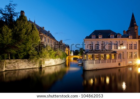 Typical houses besides a canal Bruges, Belgium. - stock photo