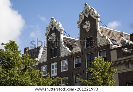 Typical houses with clear spring sky, Amsterdam, the Netherlands - stock photo