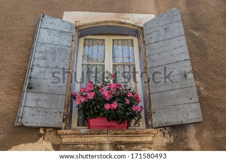 Typical iconic window located in old city of Provence, France - stock photo