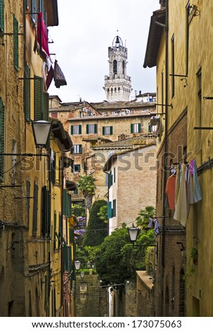 Typical Italian alley, Siena, Tuscany, Italy - stock photo