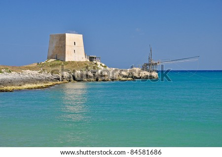 Typical lookout tower on the coast of Gargano. Apulia. Italy. - stock photo