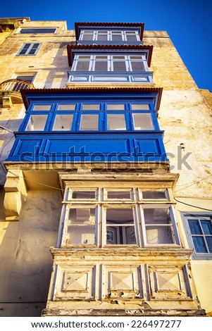 Typical Maltese covered balconies in Valletta - stock photo
