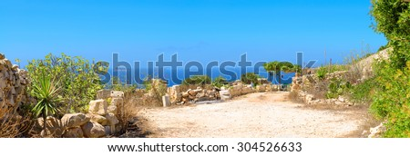 Typical Maltese stone shed facing the sea on a bright sunny day. Malta, stone cliffs close to Zurrieq. - stock photo