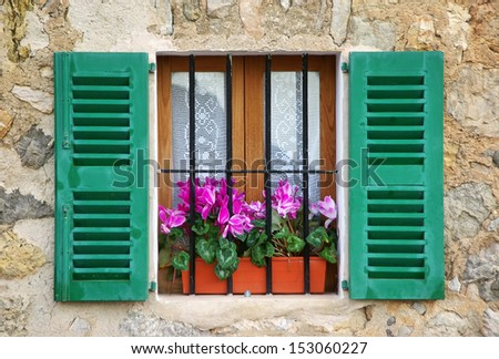 Typical mediterranean window in a house of the village of Deia in Majorca (Spain) - stock photo