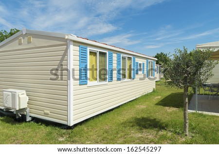 typical mobil home on a campsite in italy - stock photo