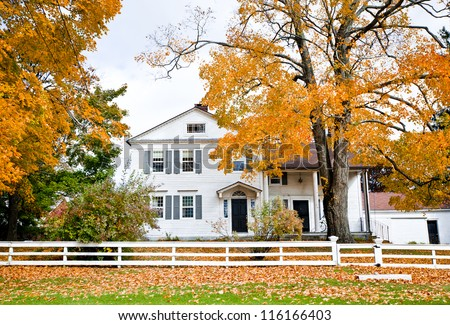 Typical New England colonial style house in the fall - stock photo
