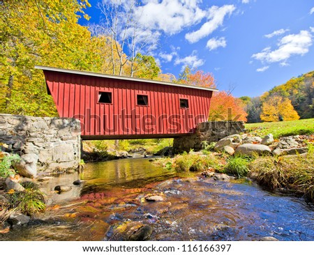 Typical new England covered bridge in the fall - stock photo