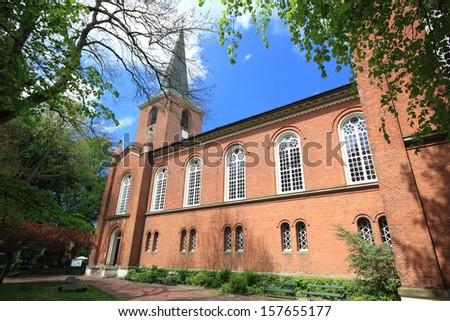 typical northern geman church in brickstone architecture. aurich, germany - stock photo