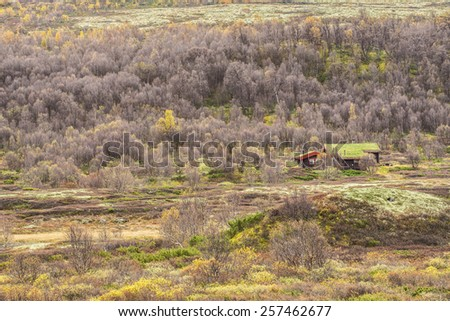 Typical norwegian cabin with turf roof in Rondane National Park, Norway - stock photo