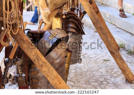 Typical object used by the Roman legions of the Roman Empire. Flexible armour made up of metal strips held together with metal ties and the Gladius, the swords on the right. - stock photo