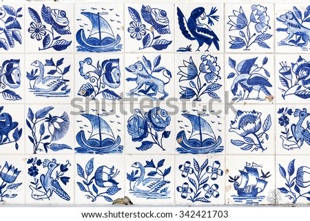 Typical old blue azulejos on the public building exterior in Alfama district, Lisbon, Portugal. - stock photo