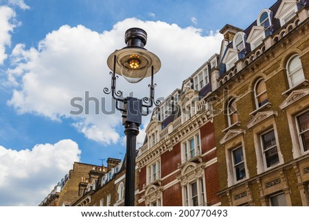typical old buildings with an old street lamp in front in Notting Hill, London - stock photo