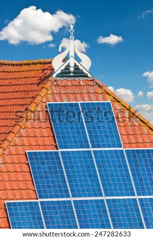 Typical old Dutch farm from Friesland with solar panels on the roof - stock photo