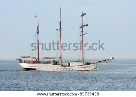 Typical old Dutch three mast clipper  sailing on the sea - stock photo