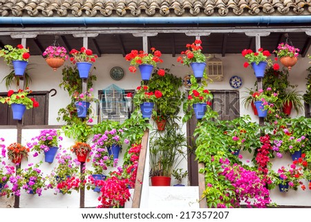 Typical old Terrace (balcony) decorated Pink and Red Flowers, Cordoba, Spain, Mediterranean Europe 10 of May 2013 - stock photo