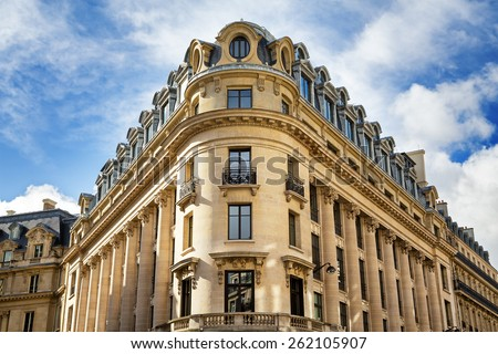 Typical Parisian architecture in the centre of Paris, France. Decorative appartment building on spring day.  - stock photo