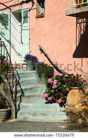 Typical pink French pastel colored village door in Provence - stock photo