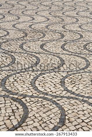 Typical Portuguese 'calcada' mosaic cobble stone paving, Algarve, Portugal. - stock photo
