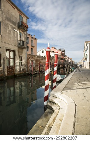 Typical Red and White mooring pole, Venice Italy - stock photo