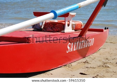 Typical red rescue boat by the sea, Rimini, Italy - stock photo