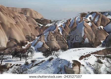 Typical rock formations in Cappadocia, Turkey - stock photo