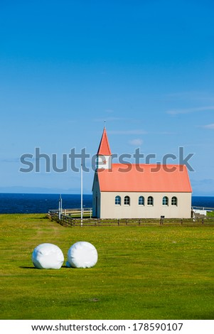 Typical Rural Icelandic Church under a blue summer sky. Vertical shot - stock photo