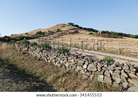 typical Sardinian landscape in a deserted scene with rocks - stock photo