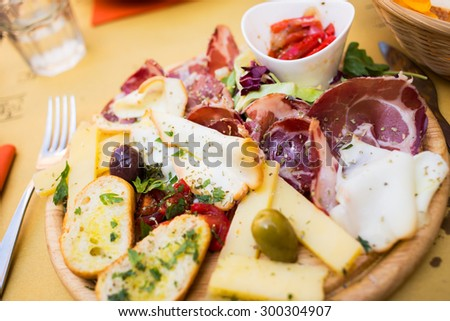 Typical sicilian antipasto appetizer with ham, cheese, olives etc - stock photo