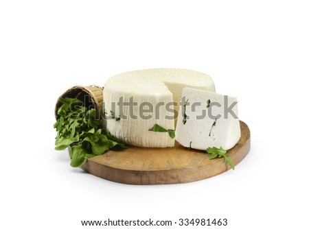 Typical Sicilian cheese from sheep, with rocket salad. On white background - stock photo