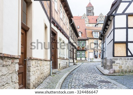Typical small street in in Quedlinburg town, Germany - stock photo
